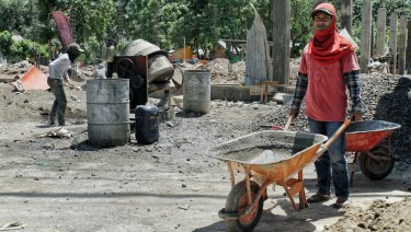 Amrulah working at a construction site in his village of Nipah in north Lombok.