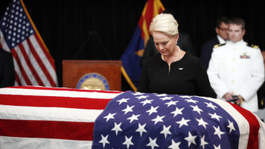 Cindy McCain, wife of Senator John McCain, looks at the casket during a memorial service at the Arizona Capitol.