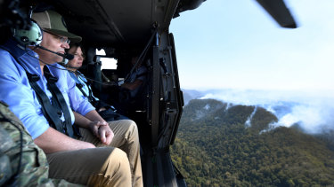 Mr Morrison and wife Jenny are flown over the Gold Coast hinterland.