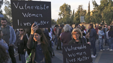 Hundreds of people turned out in front of Cyprus' presidential palace in Nicosia on Friday to remember five women and two girls that a military officer says he killed.