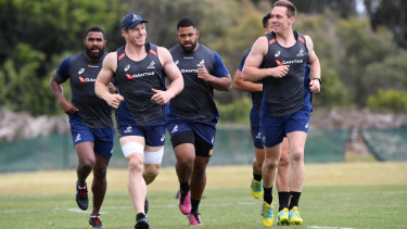 Doing it with a smile: David Pocock, front left, and Dane Haylett-Petty, front right, were injured in the Wallabies January fitness camp.