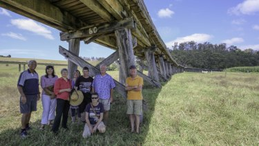 Peter Dreverman (far right), a third-generation Orbost farmer, is among those campaigning to save and restore the bridge.