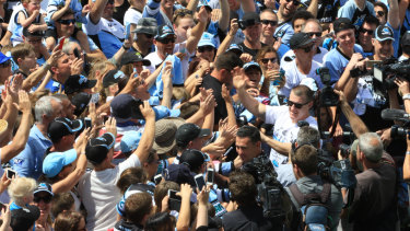 Flanagan and Paul Gallen are mobbed by fans after their 2016 NRL grand final victory.