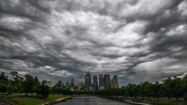 Storm clouds gather over Melbourne after thunderstorm asthma warnings were issued.