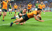 Ikitau scores a try against the Springboks on Saturday.