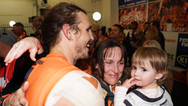 'Warrior': Phil Davis enjoys the victory with his family at the MCG.