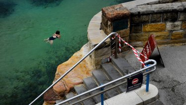 A woman swims at Coogee Beach.