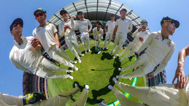Circling in: The Australian team huddle on the MCG during day four of the Boxing Day Test.