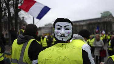 Yellow vest protesters march during a demonstration in Lille, northern France, on Saturday.