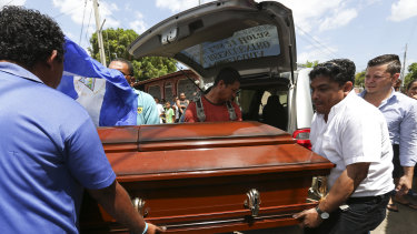 Men carry the casket of Alvaro Manuel Conrado Davila, a 15-year-old student who died during the protests on Friday.