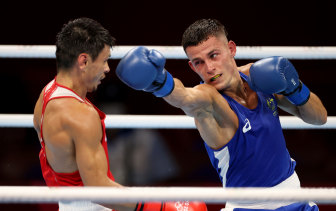 Harry Garside exchanges punches with Zakir Safiullin during his quarter-final in Tokyo.