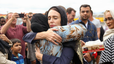 Jacinda Ardern hugs a woman at a mosque in Wellington, two days after the Christchurch mosque shootings.