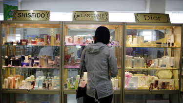 A woman looks at a display of imported cosmetics and perfume on the second level of the upscale Potonggang department store in Pyongyang, North Korea.