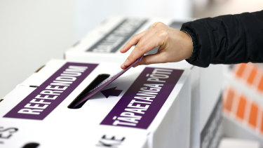 A person casts their referendum vote during election day on October 17.