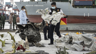 Indonesian authorities have been sorting through debris found in the Java Sea.