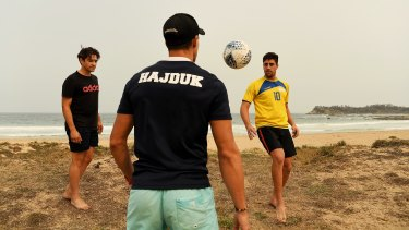 Daniel Jadric from Canberra (in yellow) at Malua Bay with his brother Josip (centre) and friend Nikolas Barisic (left).