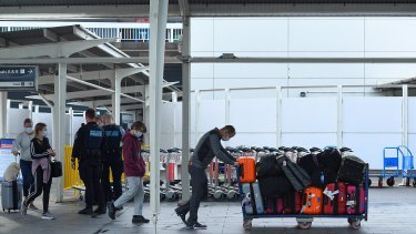 Passengers arrive at Sydney International Airport from Los Angeles that arrived just after 6am on Thursday.
