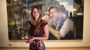 Tessa MacKay poses with her Packing Room prize portrait of David Wenham.