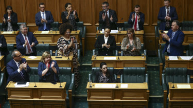 Prime Minister Jacinda Ardern is applauded by colleagues after her speech.