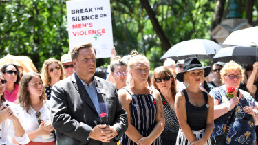 Protesters are seen during a domestic violence protest organised by The Red Rose Foundation in Brisbane, Friday, February 21, 2020.