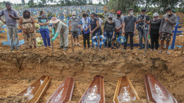 Victims of the coronavirus pandemic are buried in Brazil.