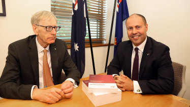 Kenneth Hayne (left) hands over the final report from the banking royal commission to Treasurer Josh Frydenberg on February 1.