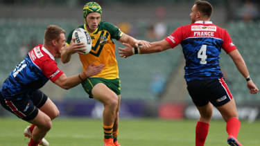 Junior Kangaroos five-eighth Kalyn Ponga spots a gap against France in Wollongong on Friday.