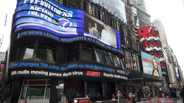 The ABC News ticker displays market updates and the possibility of the NBA moving games due to the coronavirus on March 11. The season was later suspended.