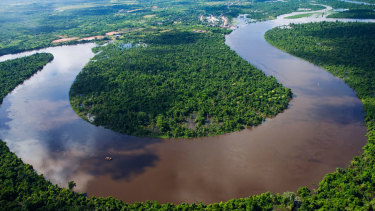 The Nanay River, a tributary of the Amazon River, bends in the Peruvian jungle.