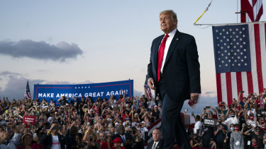President Donald Trump arrives for a campaign rally at Orlando Sanford International Airport on Monday.