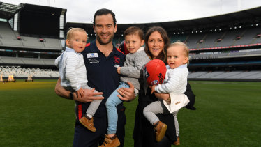 Jordan Lewis and wife Lucy pose with their kids Hugh, Freddie and Ollie at the MCG.