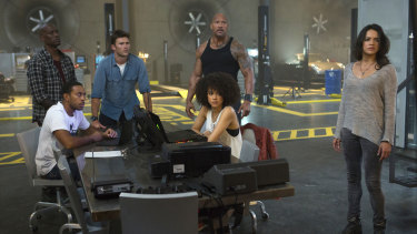 """Some of the cast of The Fate of the Furious: Chris """"Ludacris"""" Bridges, seated left, and Nathalie Emmanuel, seated right, and Tyrese Gibson, standing from left, Scott Eastwood, Dwayne Johnson and Michelle Rodriguez."""