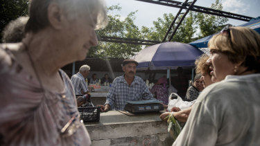 Grisa Muntean, centre, at the market town of Telenesti, 35 kilometres from his home.