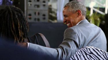 Former US President Barack Obama speaks with his half sister Auma Obama, in Kogelo, Kenya.
