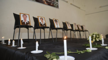 Framed photographs of seven crew members are displayed at a memorial service held by an association of Ethiopian airline pilots in Addis Ababa.