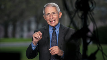 Dr Anthony Fauci, director of the National Institute of Allergy and Infectious Diseases, speaks during a television interview at the White House.