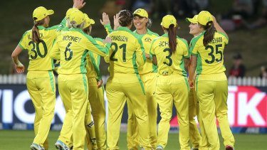The Australians celebrate after the dismissal of New Zealand captain Sophie Devine.