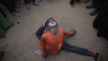 Palestinians give a circus performance as part of an ongoing protest at the Gaza Strip's border with Israel on Wednesday. Hamas has called for Palestinians to amass at the border as part of a week-long campaign of protests.