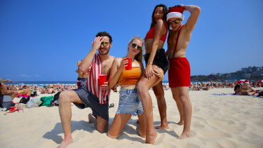 French tourists Louis Duverger, Alina Truc, Cassandre Agostene and Anthony Leveau on Christmas Day at Bondi Beach.