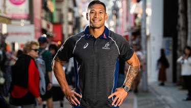 Star attraction: Folau posed for the cameras at a Wallabies fan event at the Asics store in Tokyo last year but was dumped by the brand last month after his anti-gay Instagram post.