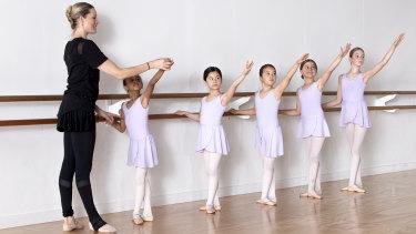 Dance teacher Rain Francis instructs pupils.