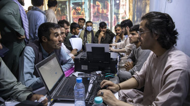 Afghans in the Herat Kabul internet cafe.