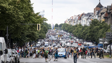 Demonstrators walk along Bismarckstrasse in Berlin.