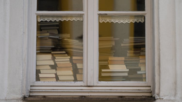 Books piled up in the window of a library in Bavaria. COVID-19 has led to library closures around the world.