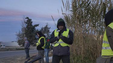 Migrants seeking day labour on farms gather in El Ejido, Spain, on January 23.