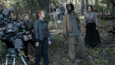 Writer-director Jennifer Kent, left, directs Baykali Ganambarr and Aisling Franciosi on the Tasmanian set of The Nightingale.