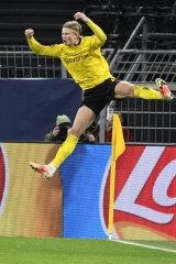 Erling Haaland celebrates scoring Dortmund's second goal.