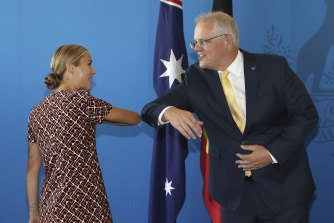Australian of the Year Grace Tame and Prime Minister Scott Morrison share an elbow bump in Canberra in January.