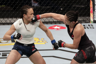 Carla Esparza, right, lands a punch on Michelle Waterson during UFC 249 on Saturday in Jacksonville.