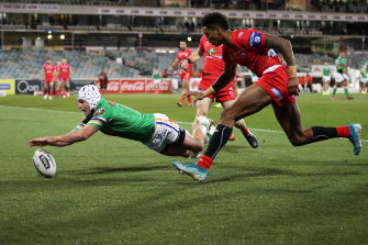 Jarrod Croker dives over to score a try under pressure from Jason Saab.